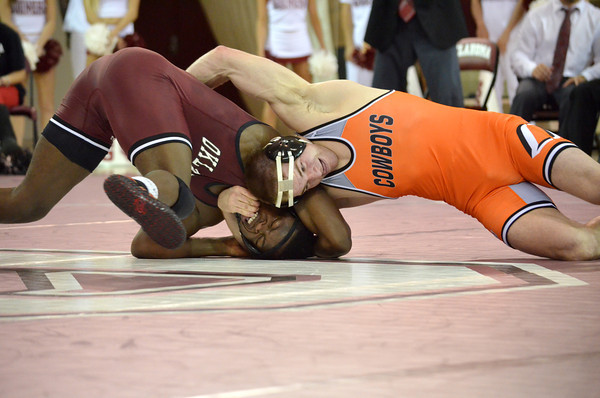 OU's Matt Reed tries to break free from Oklahoma State's Chris Perry   Sunday during the Bedlam wrestling match at the McCasland Field House at the University of Oklahoma.<br /> Kyle Phillips/The Transcript