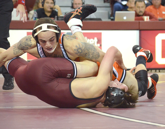 Oklahoma State's Jordan Oliver tries to pin OU's Nick Lester Sunday during the Bedlam wrestling match at the McCasland Field House at the University of Oklahoma.<br /> Kyle Phillips/The Transcript