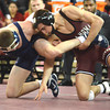 OU's Cody Brewer tries to get control of West Virginia's Colin Johnston during the Sooners' match against the Mountaineers Sunday at the McCasland Field House.<br /> Kyle Phillips/The Transcript