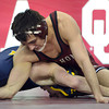OU's Kyle Garcia tries to put a hold on West Virginia's Shane Young during the Sooners' match against the Mountaineers Sunday at the McCasland Field House.<br /> Kyle Phillips/The Transcript