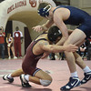 OU's Cody Brewer lunges at  West Virginia's Colin Johnston during the Sooners' match against the Mountaineers Sunday at the McCasland Field House.<br /> Kyle Phillips/The Transcript