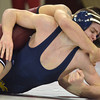 OU's Cody Brewer puts West Virginia's Colin Johnston in a head lock  during the Sooners' match against the Mountaineers Sunday at the McCasland Field House.<br /> Kyle Phillips/The Transcript