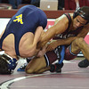 OU's Kendric Maples puts a hold on West Virginia's Nathan Pennesi  during the Sooners' match against the Mountaineers Sunday at the McCasland Field House.<br /> Kyle Phillips/The Transcript