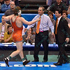 ALEX DIERINGER of Oklahoma State rushes to his coaches after he was crowned national champion in the 165 pound division at the NCAA division 1 wrestling championships held at Scottrade Center in St. Louis MO.