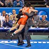 ISAIAH MARTINEZ of Illinois jumps into his coaches arms as he was crowned national champion in the 157 pound division at the NCAA division 1 wrestling championships held at Scottrade Center in St. Louis MO.