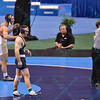 An official signals a one point violation that gives MATTHEW BROWN of Penn State the national champion in the 174 pound division at the NCAA division 1 wrestling championships held at Scottrade Center in St. Louis MO.
