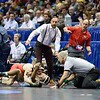 Ohio State coaches LOU ROSSELLI and ROSS THATCHER react to the action in front of them during the NCAA division 1 wrestling championships held at Scottrade Center in St. Louis MO.