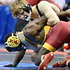 CORY CLARK of Iowa has EARL HALL of IOWA STATE tied up in their quarterfinal match during the NCAA division 1 wrestling championships held at Scottrade Center in St. Louis MO.