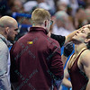 CHRISTOPHER DARDANES  of Minnesota gets his chin worked on to stop the bleading in his quarterfinal match during the NCAA division 1 wrestling championships held at Scottrade Center in St. Louis MO.