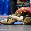 EARL HALL of Iowa State arches his back to avoid being pinned by CORY CLARK of Iowa in their quarterfinal match during the NCAA division 1 wrestling championships held at Scottrade Center in St. Louis MO.