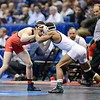 NATHAN TOMASELLO of Ohio State locks up with KORY MINES of Edinboro in their quarterfinals match during the NCAA division 1 wrestling championships held at Scottrade Center in St. Louis MO.