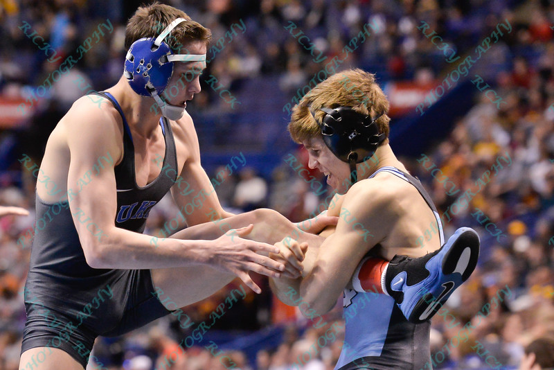 MITCH FINESILVER of Duke has his leg held by TROY HEIMANN of North Carolina during the second round of the consolation bracket of the NCAA division 1 wrestling championships held at Scottrade Center in St. Louis MO.