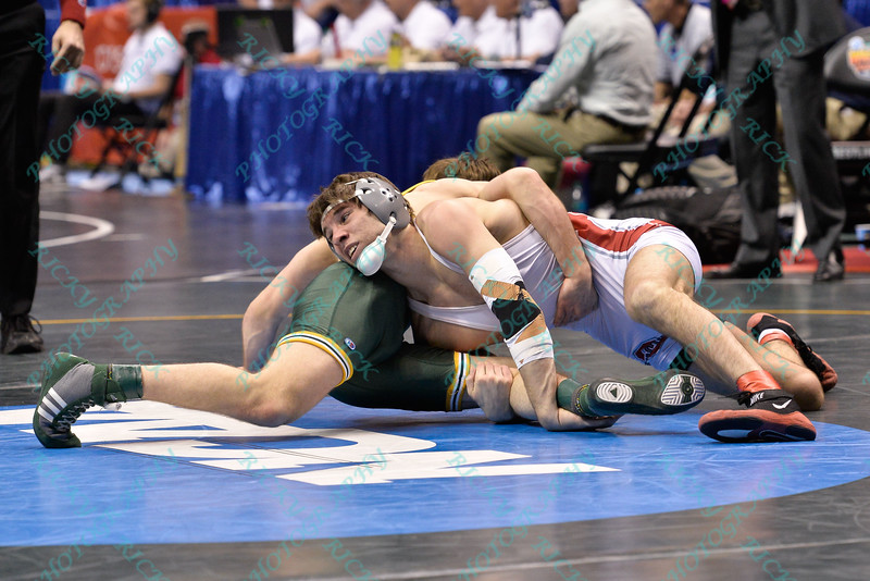 HUNTER STIEBER of Ohio State attempts to take control over CLAYTON REAM of North Dakota State during the second round of the wrestleback bracket of the NCAA division 1 wrestling championships held at Scottrade Center in St. Louis MO.