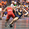 NAHSHON GARRETT of Cornell takes down ZEKE MOISEY of West Virginia during the second round of the championship bracket of the NCAA division 1 wrestling championships held at Scottrade Center in St. Louis MO.