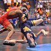 ZEKE MOISEY of West Virginia gets turned upside down by NAHSHON GARRETT of Cornell during the second round of the championship bracket of the NCAA division 1 wrestling championships held at Scottrade Center in St. Louis MO.