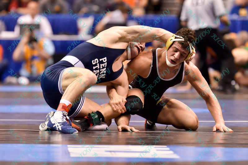 MATTHEW BROWN of Penn State has control over SANTIAGO MARTINEZ of Lehigh during the second round of the championship bracket of the NCAA division 1 wrestling championships held at Scottrade Center in St. Louis MO.