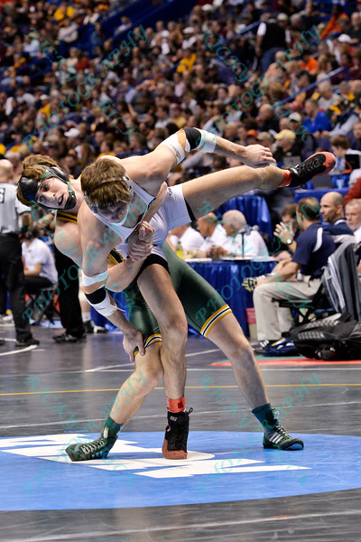 CLAYTON REAM of North Dakota State takes down HUNTER STIEBER of Ohio State during the second round of the consolation bracket of the NCAA division 1 wrestling championships held at Scottrade Center in St. Louis MO.