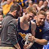 ZEKE MOISEY of West Virginia gets congratulated by SAMMIE HENSON after his big upset victory during the second round of the championship bracket of the NCAA division 1 wrestling championships held at Scottrade Center in St. Louis MO.