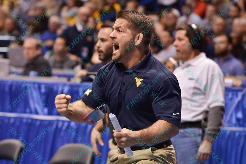 West Virginia head coach SAMMIE HENSON celebrates his players upset victory during the second round of the championship bracket of the NCAA division 1 wrestling championships held at Scottrade Center in St. Louis MO.