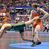 KURTIS JULSON of North Dakota State lunges in an effort to pull his leg free of the hold by ZACH EPPERLY of Vermont during the second round of the championship bracket of the NCAA division 1 wrestling championships held at Scottrade Center in St. Louis MO.