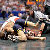 LOGAN STIEBER of Ohio State rolls MIKE MORALES of West Virginia onto his back in a pin attempt during the second round of the championship bracket of the NCAA division 1 wrestling championships held at Scottrade Center in St. Louis MO.