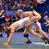 NICK SNYDER of Ohio State attempts to take down SHANE WOODS of Wyoming during the second round of the wrestleback bracket of the NCAA division 1 wrestling championships held at Scottrade Center in St. Louis MO.