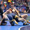 NICK HERMANN of Virginia attempts to reverse positions with TREY ANDREWS of Northern Coloroda during the second round of the wrestleback bracket of the NCAA division 1 wrestling championships held at Scottrade Center in St. Louis MO.