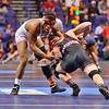 SCOTT PATRICK of Davidson shoots for a leg take down on KENNY COURTS of Ohio State during the second round of the championship bracket of the NCAA division 1 wrestling championships held at Scottrade Center in St. Louis MO.