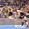ANTHONY ASHNAULT of Rutgers send ZACHARY HORAN of Central Michigan flying during a takedown during the second round of the championship bracket of the NCAA division 1 wrestling championships held at Scottrade Center in St. Louis MO.