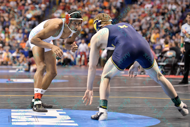 JOSH DEMAS of Ohio State squares off with BRIAN MURPHY of Michigan during the second round of the championship bracket of the NCAA division 1 wrestling championships held at Scottrade Center in St. Louis MO.