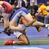 MARK MARTIN of Ohio State has SEAN MAPPES of Chattanooga draped over his shoulders during the second round of the wrestleback bracket of the NCAA division 1 wrestling championships held at Scottrade Center in St. Louis MO.