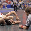 NATHAN TOMASELLO of Ohio State gets close to a pin on JOE DEANGELO of North Carolina State during the pigtail and first round competition of the NCAA division 1 wrestling championships held at Scottrade Center in St. Louis MO.