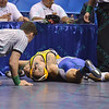 DOMINIC PARISI of Appalachian State fights off a pin attempt by JOSH MARTINEZ of Airforce during the pigtail and first round competition of the NCAA division 1 wrestling championships held at Scottrade Center in St. Louis MO.
