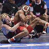 TIM LAMBERT of Nebraska has NAHSHON GARRETT of Cornell wrapped up from behind in their 125 pound match during the pigtail and first round competition of the NCAA division 1 wrestling championships held at Scottrade Center in St. Louis MO.