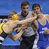 DOMINIC PARISI of Appalachian State pushes JOSH MARTINEZ away in their 125 pound match during the pigtail and first round competition of the NCAA division 1 wrestling championships held at Scottrade Center in St. Louis MO.
