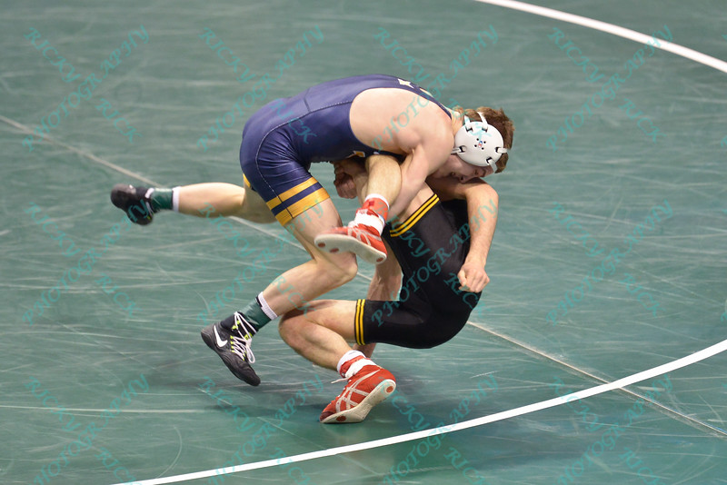 ZEKE MOISEY of West Virginia takes down THOMAS GILMAN of Iowa for a quick pin in their semi-final match during the NCAA division 1 wrestling championships held at Scottrade Center in St. Louis MO.