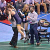 ZEKE MOISEY of West Virginia jumps into the arms of his head coach SAMMIE HENSON in their semi-final match during the NCAA division 1 wrestling championships held at Scottrade Center in St. Louis MO.