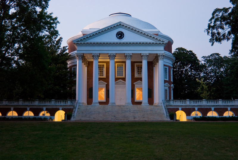 The Rotunda at the University of Virginia at dusk with the lights on.