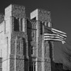 Burruss Hall Tower with the American Flag in black and white