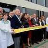 Mike McMahon - The Record, Hudson Valley Community College students hold the ribbon for the opening of its $47.4 million, 100,000-square-foot Science Center., Thursday 10/10/2013.