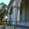 """""""THE BODDIE MANSION"""" - Circa 1848 (also known as """"The Mansion"""" and """"The Robert O. Wilder Building"""")<br /> <br /> """"We must not measure greatness from the mansion down, but from the manger up."""" ~ Jesse Jackson<br /> <br /> I love touring college and/or university campuses and discovering the history of such places; and since I was in the area, I decided to visit this private, historic college campus. Currently a work in progress and under construction, although I did take it upon myself to take a peak inside. The interior of the entire mansion has been gutted.<br /> <br /> """"The 'Mansion' was constructed in 1848 on the Boddie Plantation of 2,000 acres. John Boddie's fiancee demanded she have the fairest house in Madison County, Mississippi with a cupola from which she could view the city of Jackson. Before the Mansion was complete, she married another gentleman. Some said she was fickle; others said she was repulsed by the harsh way Boddie used his slave laborers. Disappointed in love, Boddie used the Mansion to store his cotton crop and he used the cupola to observe (not Jackson) but the progress of his field hands. The Boddie Mansion is one of the few houses in the Jackson area that withstood the Civil War and now houses the administrative offices of Tougaloo College."""" ~ Reprinted text from here:<br /> <br /> <a href=""""http://www.visitjackson.com/Discover-Jackson/Heritage"""">http://www.visitjackson.com/Discover-Jackson/Heritage</a><br /> <br /> """"The Robert O. Wilder Building, also known as """"The Mansion"""", stands in the center of the Tougaloo College campus, overlooking the ensemble of buildings forming the college's historic core. The Mansion holds important architectural and historical significance for the college, the community of Jackson and the state of Mississippi. Originally constructed in 1860 as the home of a wealthy cotton planter and the centerpiece of his plantation, The Mansion became the nucleus for one of the first schools established in Mississippi to educ"""
