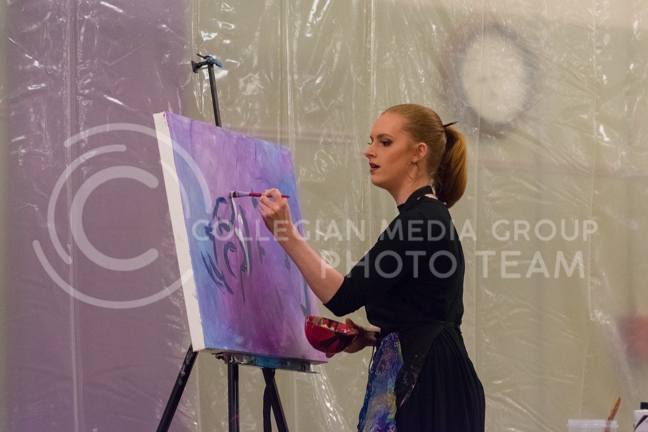Annika Wooton demonstrated her speed painting skills for the audience in between painting sessions. Annika graduated from The University of Kansas in 2017 with a BFA in Illustration and Design. (Alex Todd | Collegian Media Group)