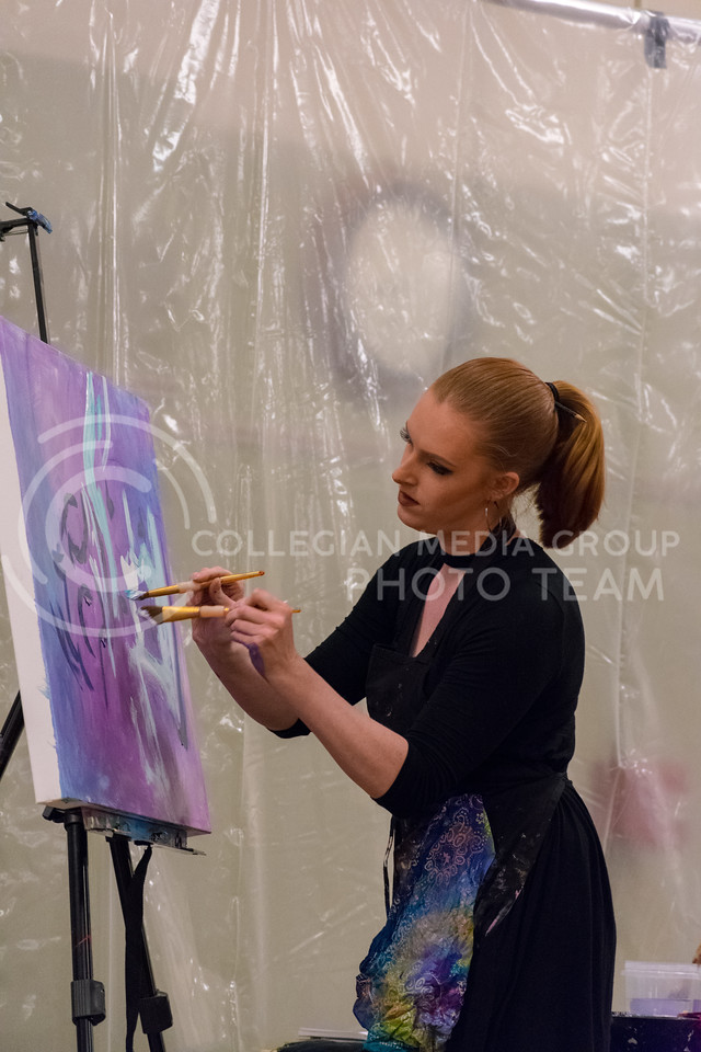 An image starts to form as Annika uses two brushes at the same time.  In her spare time Annika participates in the Miss America Organization and is Miss Leavenworth County 2018. (Alex Todd | Collegian Media Group)