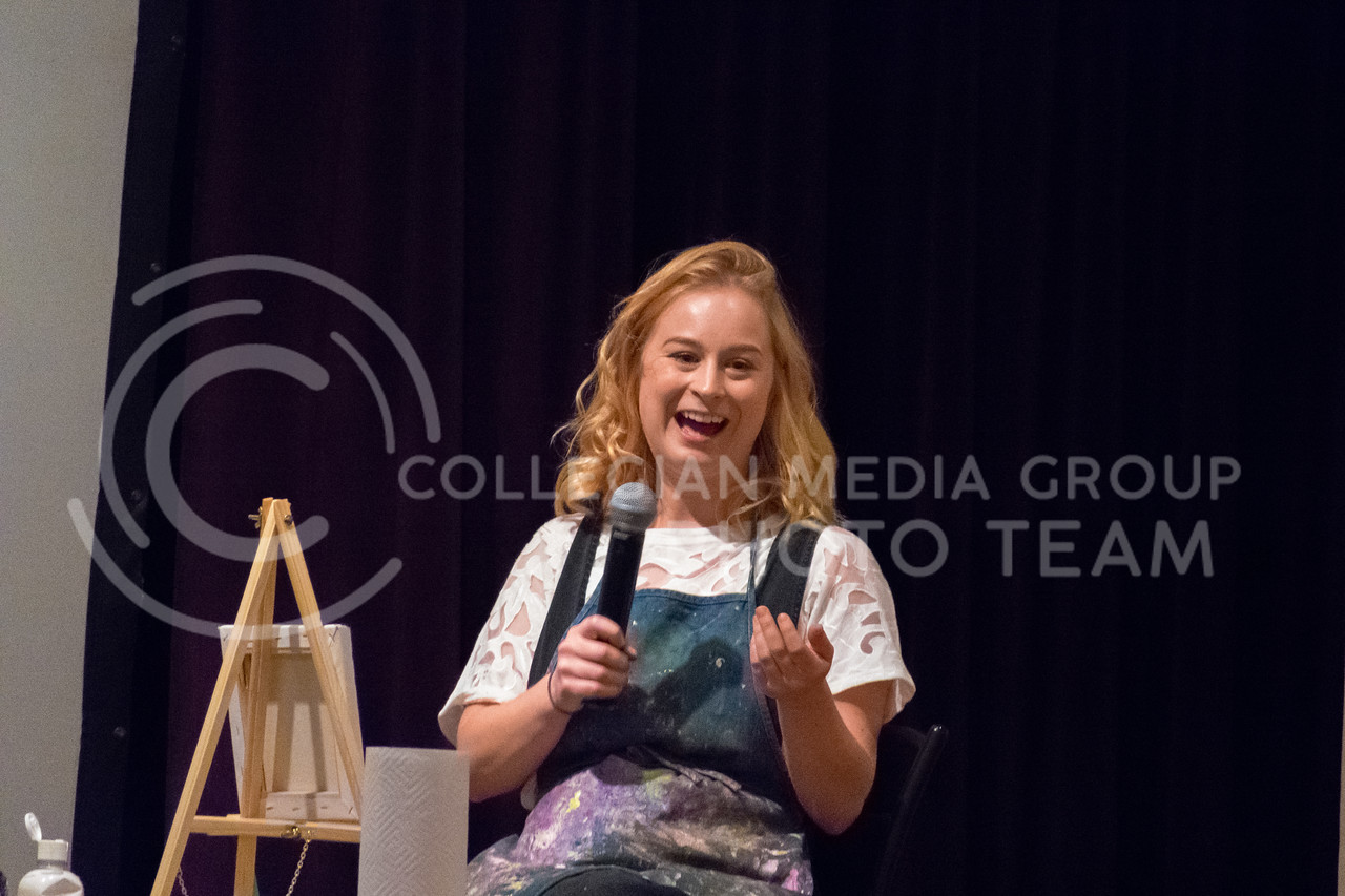 Starting off the night with a cheesy pun, Jessie Burnes laughs as the audience enjoys her play on words. (Alex Todd | Collegian Media Group)