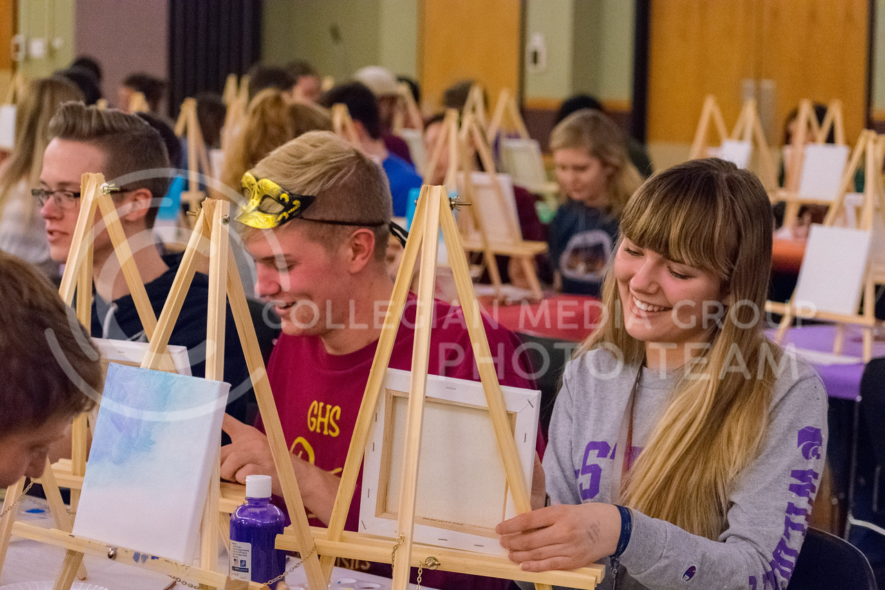 Ethan Doherty, Freshman in Architecture, and Interior Design Freshman Megan Beckel enjoy painting their own sky scenery at the Happy Trees Painting event in the Union on January 26. (Alex Todd | Collegian Media Group)