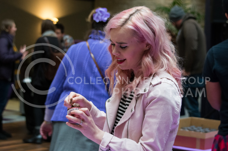 After performing, Krigarè tops off her cupcake with chocolate icing at the UPC Battle of the Cupcakes in the Union on February 21. (Alex Todd | Collegian Media Group)