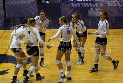 K-State celebrates a point over Arkansas during the volleyball game against Arkansas in Ahearn Field House on Aug. 31, 2017. (Nathan Jones | Collegian Media Group)
