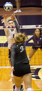 Junior outside hitter Kylee Zumach jumps to block the ball during the volleyball game against Arkansas in Ahearn Field House on Aug. 31, 2017. (Sabrina Cline | Collegian Media Group)