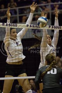 Freshman middle blocker Peyton Williams and freshman outside hitter Brynn Carlson block the ball during the volleyball game against Arkansas in Ahearn Field House on Aug. 31, 2017. (Sabrina Cline   Collegian Media Group)