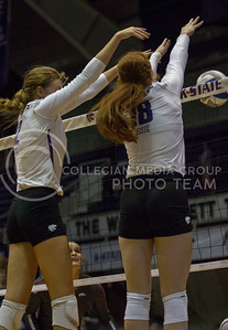 Senior opposite Bryna Vogel and junior middle blocker Macy Flowers block the ball during the volleyball game against Arkansas in Ahearn Field House on Aug. 31, 2017. (Sabrina Cline | Collegian Media Group)